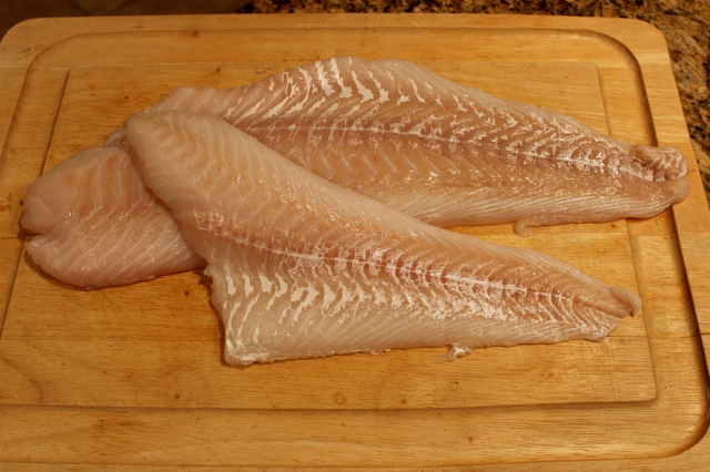 Fresh cod filets, cleaned and ready for cooking.