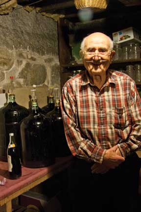 Peter Rando and his homemade wine.