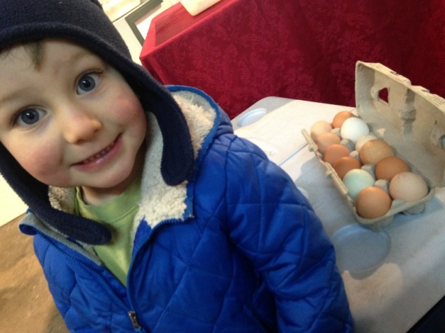 Marveling at multi-color eggs at the Marshfield Winter Market